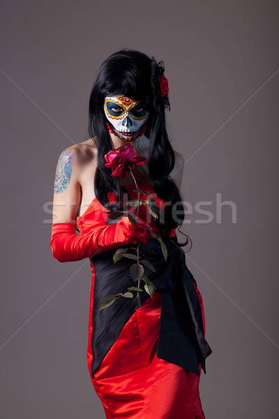 Stock photo: Sugar skull girl with rose