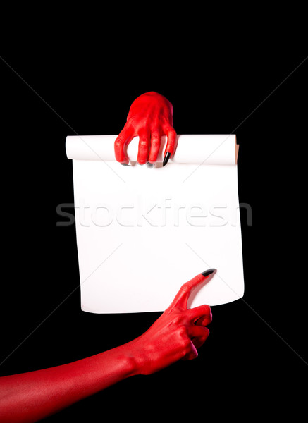 Rojo diablo manos papel desplazamiento Foto stock © Elisanth