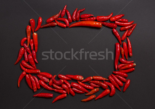 Stock photo: Frame made of non-stem red bird eye chili peppers