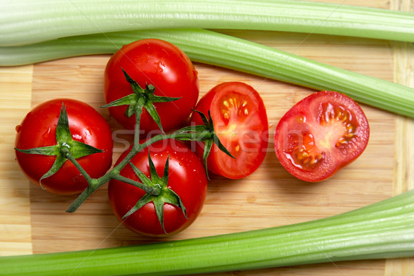 High angle view of bunch of fresh tomatoes and celery sticks  Stock photo © Elisanth