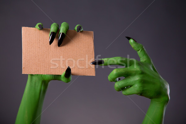 Green monster hands with black long nails pointing on blank piec Stock photo © Elisanth