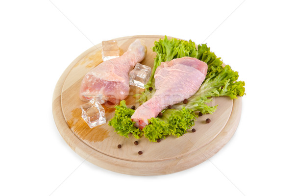 Fresh and frozen chicken legs with green salad  Stock photo © Elisanth