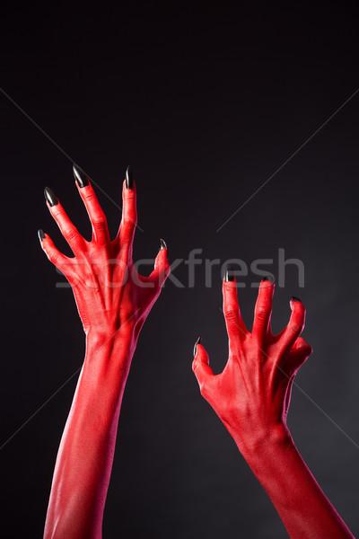 Сток-фото: красный · дьявол · рук · черный · ногти · реальный