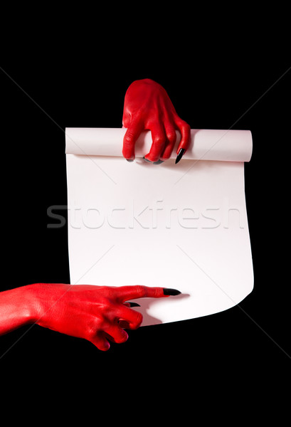 Red devil hands with black nails holding paper scroll  Stock photo © Elisanth