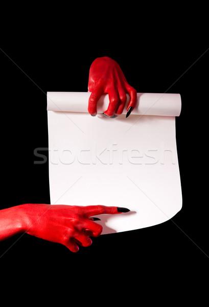 Czerwony diabeł ręce czarny paznokcie Zdjęcia stock © Elisanth