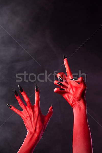 Scary red devil hands with black nails   Stock photo © Elisanth