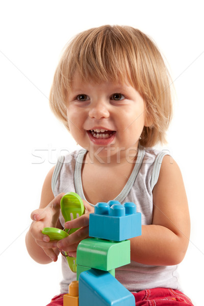 Laughing little boy playing with blocks  Stock photo © Elisanth