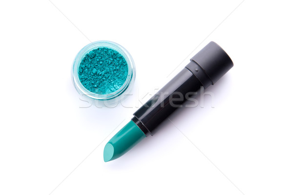 Top view of a lipstick and eye shadow in jar in bright teal gree Stock photo © Elisanth