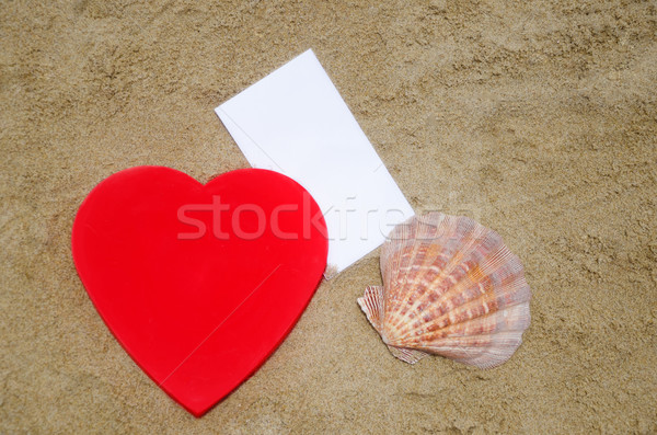 Heart, seashell and paper on the beach Stock photo © EllenSmile