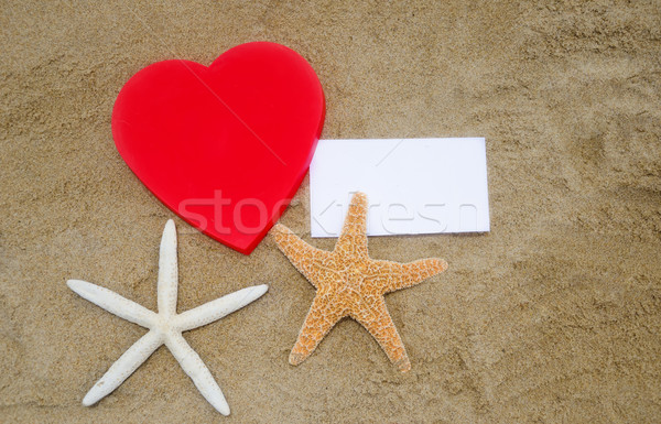 Heart shape, starfishes, and paper on the beach Stock photo © EllenSmile
