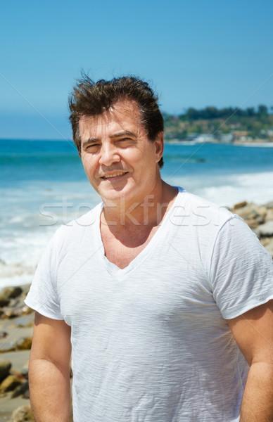 Homem retrato feliz grego praia água Foto stock © EllenSmile