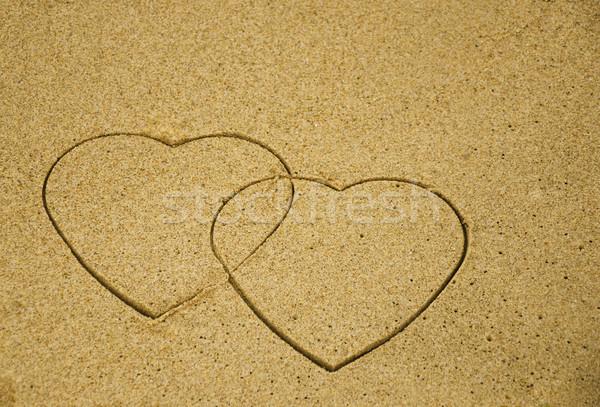 Dois corações areia praia praia Foto stock © EllenSmile
