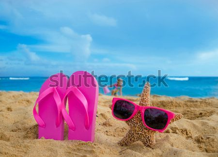 Protector solar estrellas de mar playa de arena azul gafas de sol Foto stock © EllenSmile