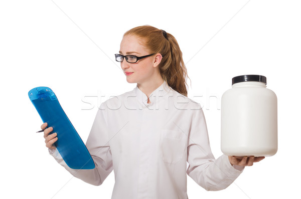Young female doctor holding jar of protein isolated on white Stock photo © Elnur