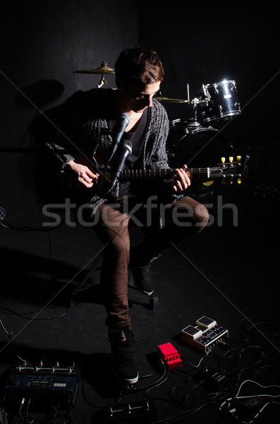 Man playing guitar in dark room Stock photo © Elnur