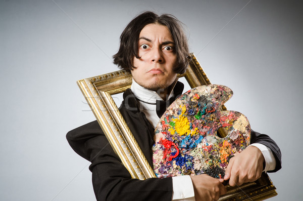 Funny artist in dark studio Stock photo © Elnur