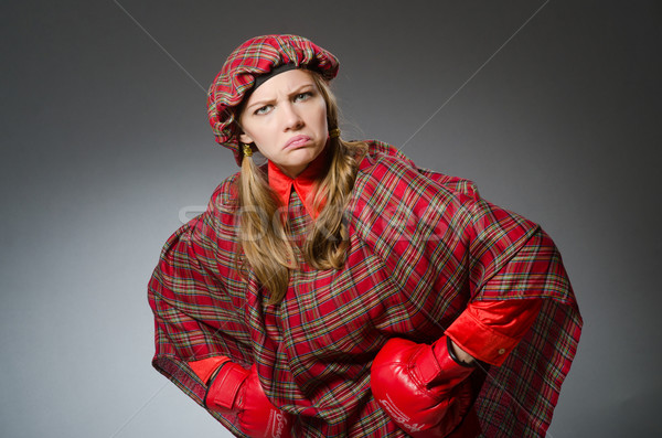 Woman in scottish clothing in boxing concept Stock photo © Elnur
