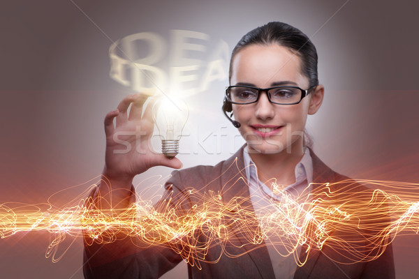 Young call center operator with bulb in idea concept Stock photo © Elnur
