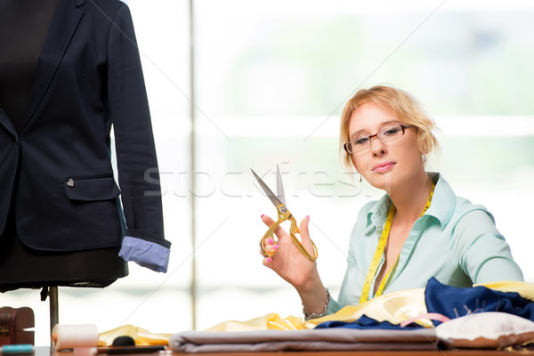 Stock photo: The woman tailor working on new clothing