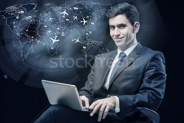 Concept of online booking with businesman and laptop Stock photo © Elnur