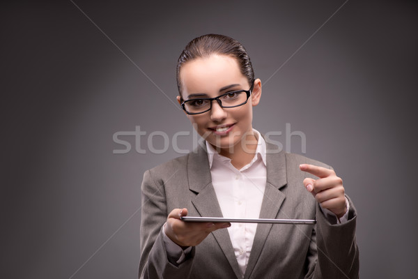 Young businesswoman working with tablet computer Stock photo © Elnur
