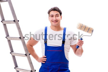 Handsome repairman wearing coveralls isolated on white Stock photo © Elnur