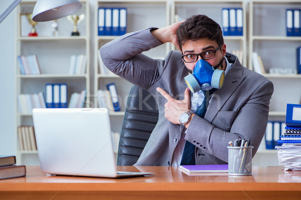 Businessman sweating excessively smelling bad in office at workp Stock photo © Elnur