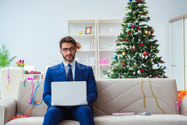 Businessman working at home during christmas Stock photo © Elnur