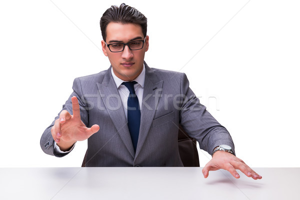 Young businessman pressing virtual buttons isolated on white bac Stock photo © Elnur