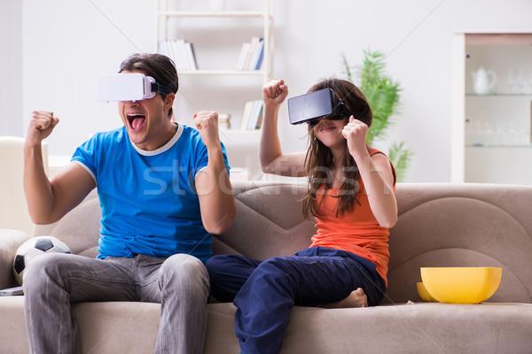 Homem assistindo futebol virtual realidade óculos Foto stock © Elnur