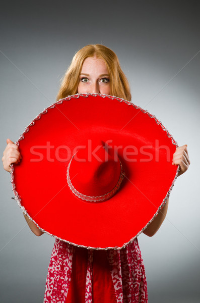 Mexican woman wearing red sombrero Stock photo © Elnur