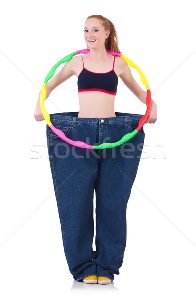 Woman in weight loss concept isolated on white Stock photo © Elnur