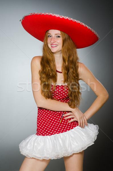 Szép nő visel piros szombréró kalap Stock fotó © Elnur