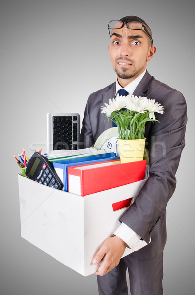 Man being fired with box of personal stuff Stock photo © Elnur