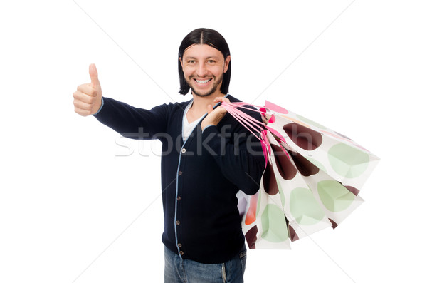 Young man holding plastic bags isolated on white Stock photo © Elnur