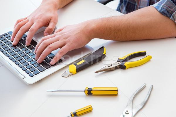 The computer repairman repairing computer laptop Stock photo © Elnur