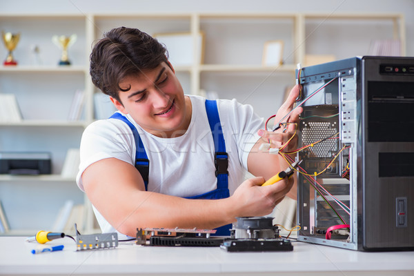 The computer repairman repairing desktop computer Stock photo © Elnur