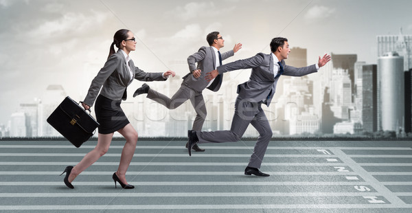 Businesspeople running in competition concept Stock photo © Elnur