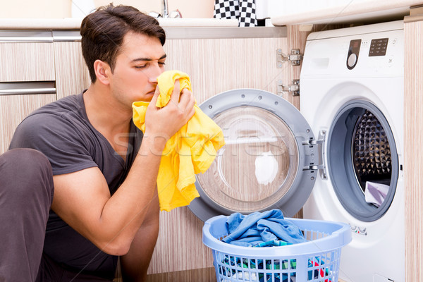 Young husband man doing laundry at home Stock photo © Elnur
