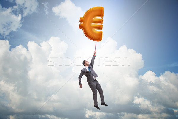 Businessman flying on euro sign inflatable balloon Stock photo © Elnur