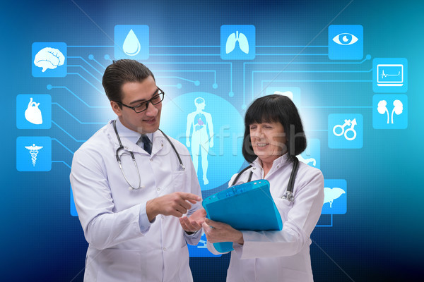Two doctors discussing issues in telemedicine concept Stock photo © Elnur