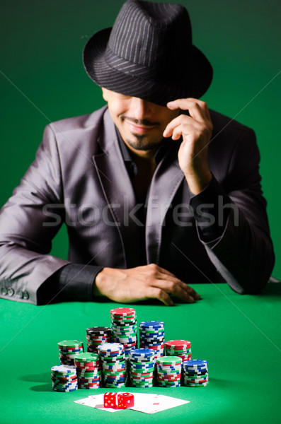 Man playing in dark casino Stock photo © Elnur