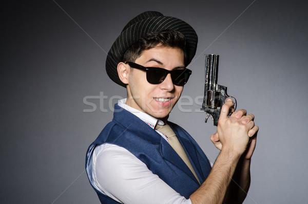 Man zonnebril pistool hand grappig Stockfoto © Elnur
