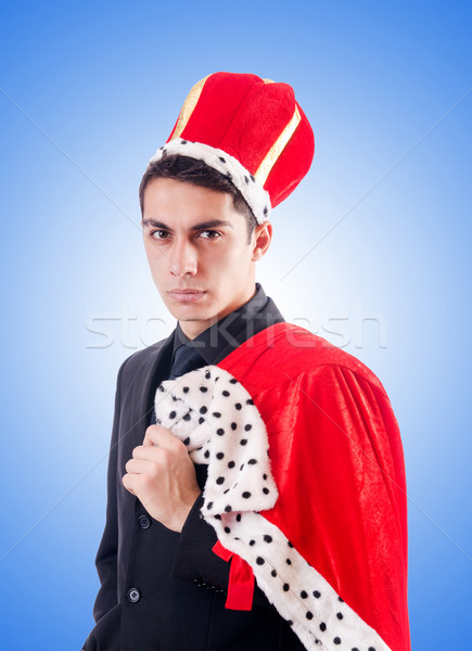 Businessman playing king against the gradient  Stock photo © Elnur