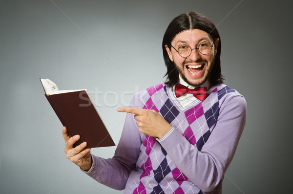 Young student with book in learning concept Stock photo © Elnur