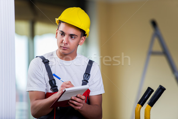 Man taking notes for delivery of boxes Stock photo © Elnur