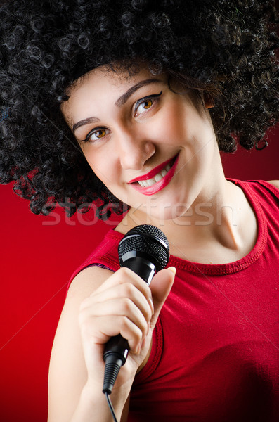 Woman with afro hairstyle singing in karaoke Stock photo © Elnur