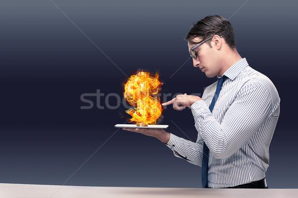 Businessman holding burning american dollar sign Stock photo © Elnur