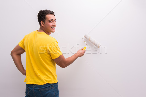 Stock photo: Man painting house in DIY concept
