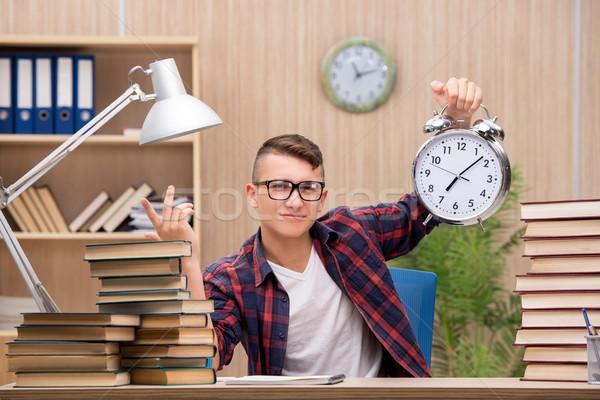 Giovani studente scuola esami libri clock Foto d'archivio © Elnur